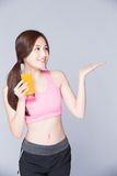 Young girl drink orange juice Royalty Free Stock Photo