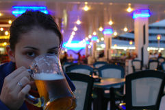 Young girl drinking a beer