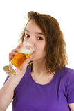 Young girl is drinking beer Royalty Free Stock Photos