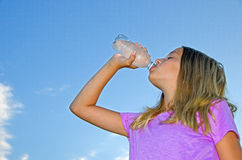 Young girl drinking bottled water Royalty Free Stock Photos