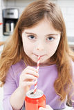 Young Girl Drinking Can Of Soda Through Straw Stock Photo