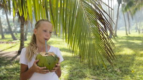 Young girl drinking coconut juice stock video
