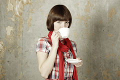 Young girl drinking coffee Stock Photography