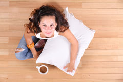 A young Girl drinking Coffee Royalty Free Stock Images