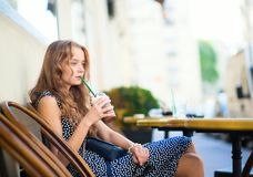 Young girl drinking coffee in a cafe Stock Photos