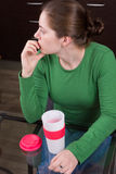 Young girl drinking coffee in kitchen Royalty Free Stock Photo