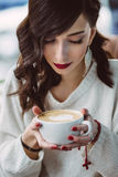 Young girl drinking coffee Royalty Free Stock Photo