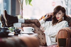 Young girl drinking coffee Royalty Free Stock Image