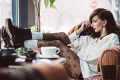 Young girl drinking coffee Royalty Free Stock Images