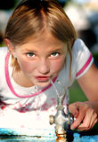 Young Girl Drinking Fountain Royalty Free Stock Image
