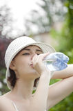 Young girl drinking fresh water Stock Photo