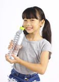Young girl drinking fresh water from a bottle Stock Images