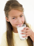 Young girl drinking glass Stock Image