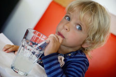 Young girl drinking from glass. Of fresh water Stock Photo