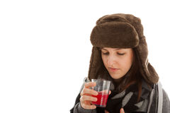 The girl is drinking a glass of medicine Stock Image