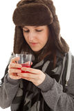 The girl is drinking a glass of medicine Royalty Free Stock Photos