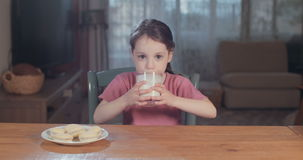 Young girl drinking a glass of milk stock video