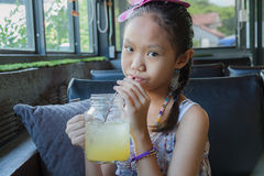 Young girl drinking juice Stock Photo
