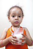 Young girl drinking milk Royalty Free Stock Image
