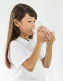 Young girl drinking milk in Studio Stock Photos
