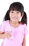 Young girl drinking milk Royalty Free Stock Images