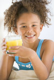 Young Girl Drinking Orange Juice In Living Room Royalty Free Stock Photo
