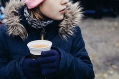 Young girl drinking popular hot non-alcoholic beverage, called Punsch in German language. Favourite children hot drink. stock photos