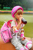 Young girl drinking and  rollerskating Royalty Free Stock Photo