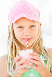 Young girl drinking smoothie Royalty Free Stock Photos