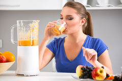 Young girl drinking tasty juice Stock Images