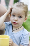 Young girl drinking tea of mug. Stock Photos