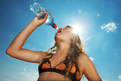 Young girl drinking water Stock Image