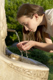Young girl drinking water Stock Photos