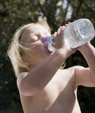 Young girl drinking water Royalty Free Stock Images