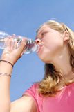 Young girl drinking water Royalty Free Stock Photo