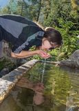 Young girl drinking water Stock Images