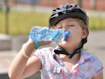 Young girl drinking water. Royalty Free Stock Photography