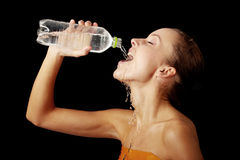 Young girl drinking water from a bottle Stock Image