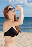Young girl drinking water from bottle Royalty Free Stock Photography