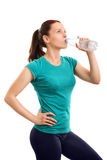 Young girl drinking water after her exercise Royalty Free Stock Photo