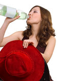 Young girl drinks water from a plastic bottle Royalty Free Stock Photography