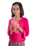 Young Girl Drinks Watermelon Juice VI. Young Asian girl drinking watermelon juice with white background Royalty Free Stock Photos