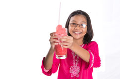 Young Girl Drinks Watermelon Juice VII. Young Asian girl drinking watermelon juice with white background Stock Photography