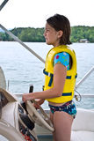 Young Girl Driving Boat Royalty Free Stock Image