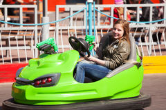 Young girl driving a bumper car Stock Image