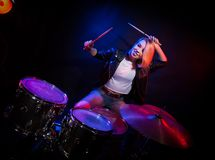 A young girl at the drums. Royalty Free Stock Images