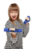 Young girl with dumbbell yells Royalty Free Stock Images