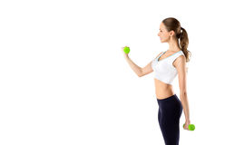 Young girl with dumbbells on a white Stock Image