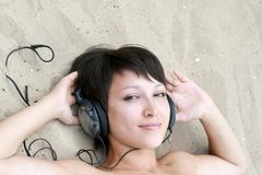 Young girl with ear-phones Stock Photography