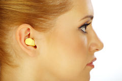 Young girl and ear plug Royalty Free Stock Photography